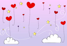 Cute heartshaped balloons flying in the sky Royalty Free Stock Photography