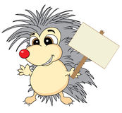 Cute hedgehog holding a wooden sign Stock Photo