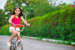 Cute hicpanic girl on bicycle Stock Images