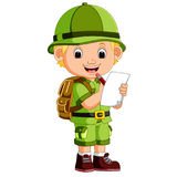 Cute hiker boy holding paper Royalty Free Stock Image