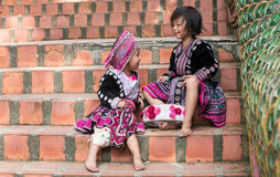 Cute Hilltribe Girl in Chiang Mai, Thailand. CHIN STATE, THAILAND - OCTOBER 15 2016: Children on the steps of Wat Doi Suthep in mourning the death of their King Stock Image