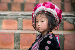 Cute Hilltribe Girl in Chiang Mai, Thailand. CHIANG MAI, THAILAND - OCTOBER 15 2016: Children on the steps of Wat Doi Suthep in mourning the death of their King Royalty Free Stock Image