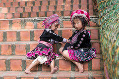 Cute Hilltribe Girl in Chiang Mai, Thailand. CHIANG MAI, THAILAND - OCTOBER 15 2016: Children on the steps of Wat Doi Suthep in mourning the death of their King Stock Images