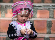 Cute Hilltribe Girl in Chiang Mai, Thailand. CHIANG MAI, THAILAND - OCTOBER 15 2016: Children on the steps of Wat Doi Suthep in mourning the death of their King Royalty Free Stock Images