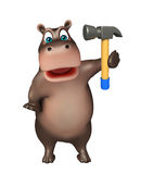 Cute Hippo cartoon character  with hammer Stock Photography