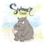 Cute Hippo with ice cream on the beach Stock Photo