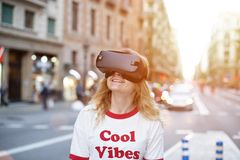 Blonde young woman uses VR headset royalty free stock photos