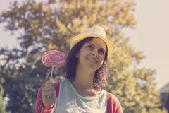 Cute hipster girl with a big lollipop Royalty Free Stock Image