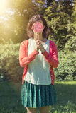 Cute hipster girl holding a big lollipop Stock Photography