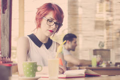 Cute hipster girl studying. Retro tones Stock Photo