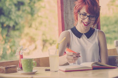 Cute hipster girl studying. Retro tones Royalty Free Stock Image