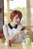 Cute hipster girl texting Royalty Free Stock Photos