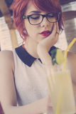 Cute hipster teenage girl in a coffee shop Royalty Free Stock Photography