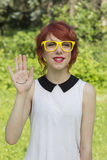 Cute hipster teenage girl showing a smiley face Stock Photo