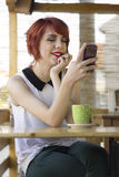 Cute hipster teenage girl text messaging Royalty Free Stock Image