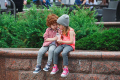 Cute hipsters drinking cocktail in park. Photo of two cute hipsters drinking cocktail in park Stock Images