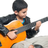 Cute Hispanic Boy Playing An Acoustic Guitar Stock Images