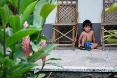 Cute Hispanic boy in time out. Cute Hispanic toddler sitting in time out Royalty Free Stock Photos