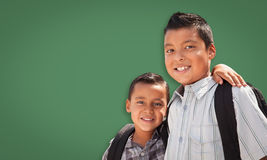 Cute Hispanic Boys In Front of Blank Chalk Board royalty free stock image