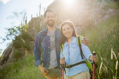 Attractive couple enjoying sunrise. Cute Hispanic couple of hikers enjoying an outdoor vacation together and smiling Stock Photos