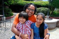 Cute Hispanic family stock photography