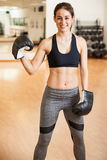 Cute Hispanic female boxer in a gym Royalty Free Stock Images