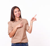Cute hispanic female pointing to her left Stock Photo