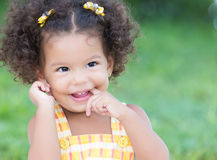 Cute hispanic girl with an afro hairstyle laughing Royalty Free Stock Images