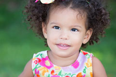 Cute hispanic girl with an afro hairstyle smiling Royalty Free Stock Photos