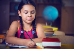 Cute hispanic girl in classroom at school Royalty Free Stock Images