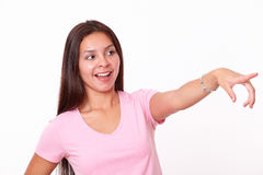 Cute hispanic girl pointing to her left Stock Photos