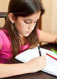 Cute hispanic girl studying at home Stock Photos