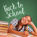 Cute Hispanic Girl Studying and Looking Up to Back To School Wri Royalty Free Stock Images
