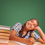 Cute Hispanic Girl Studying Looking Up to Blank Chalk Board Stock Image