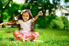 Cute hispanic girl throwing confetti Royalty Free Stock Image