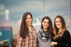 Cute Hispanic girls ready for some shopping. Group of Hispanic young women standing outside a clothing store and ready for some shopping together Royalty Free Stock Photos