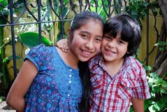 Cute Hispanic kids. A Hispanic boy and girl smiling together Royalty Free Stock Image