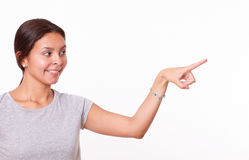 Cute hispanic lady pointing to her left Royalty Free Stock Photos