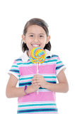 Cute hispanic little girl holding big lolly pop on Royalty Free Stock Photos