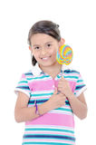 Cute hispanic little girl holding big lolly pop on Stock Image