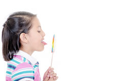Cute hispanic little girl holding big lolly pop on Stock Photography