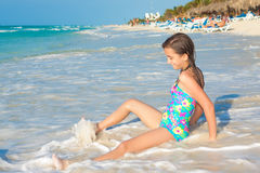 Cute hispanic teen sitting on a sunny beach in Cuba Stock Image