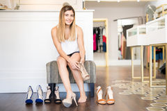 Cute Hispanic woman buying some shoes Royalty Free Stock Images