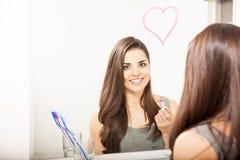 Cute Hispanic woman drawing a heart Royalty Free Stock Photos