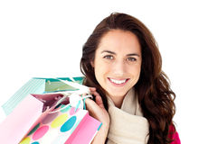 Cute hispanic woman with scarf and shopping bags Stock Photography