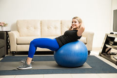 Cute Hispanic woman working out at home Stock Photo