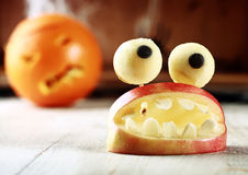 Cute homemade Halloween apple decoration Stock Photos