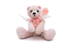 Cute homemade teddy bear with baby rattle Stock Photos