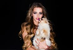 Free Cute House Dog With Beauty Woman. Pomeranian Dog Or Puppy Pet. Portrait Of Model With Beauty Make Up On Gorgeous Face Stock Image - 160086341