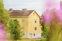Cute house is full of spring flowers stock photography